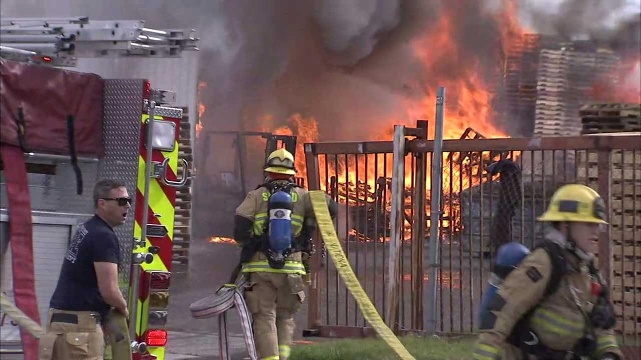 Firefighters battle a blaze at a pallet yard in Fontana on Thursday, April 6, 2017.
