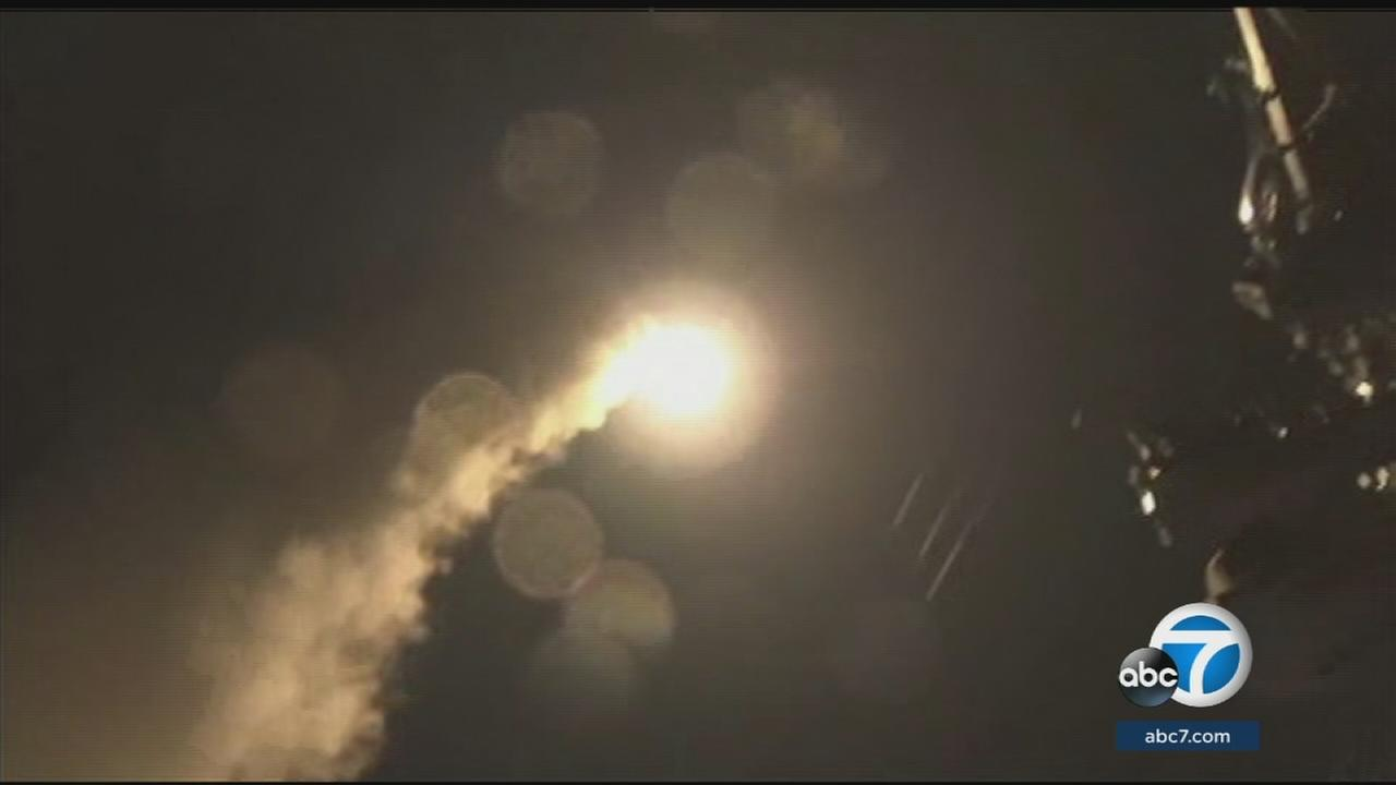 An image shows the military airstrikes on a Syrian air base launching from ships off the coast.