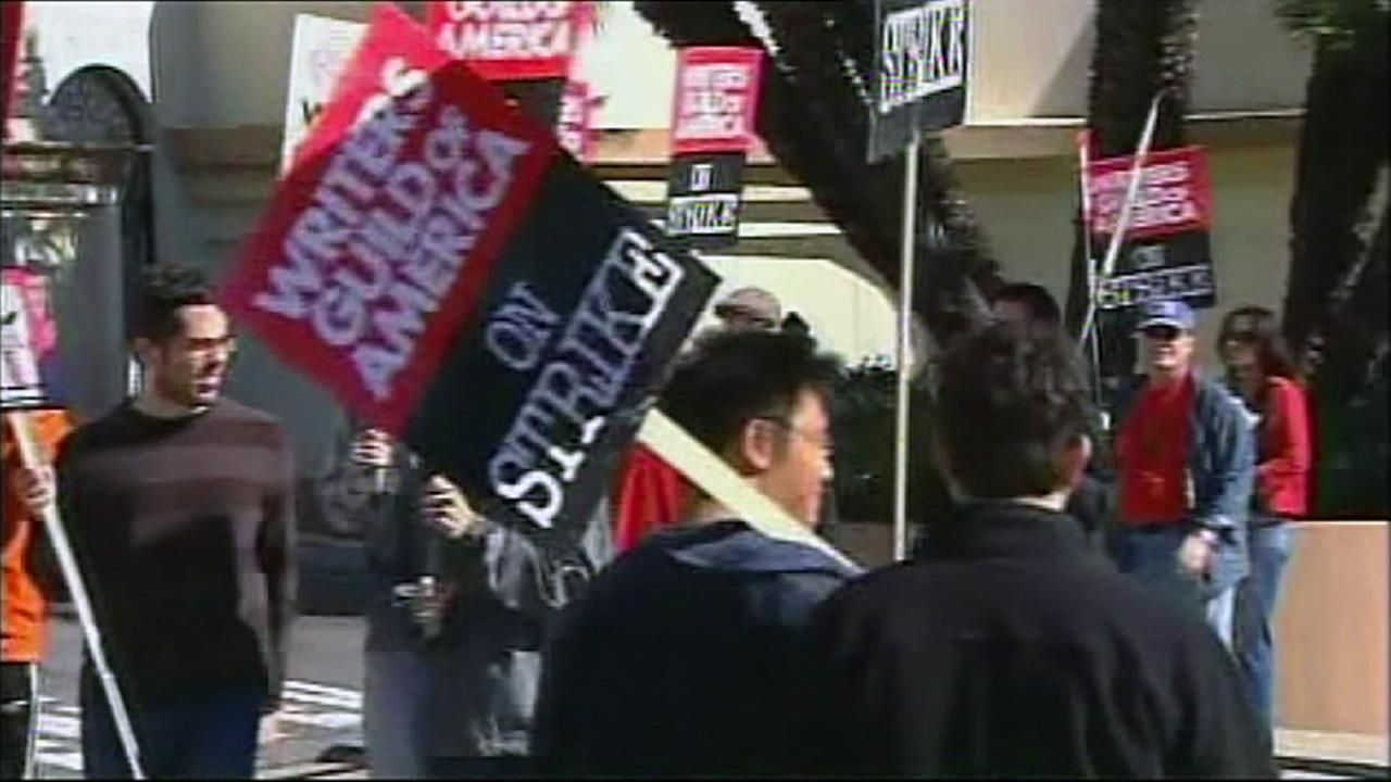 This file photo shows members of the Writers Guild of America picketing in 2007.
