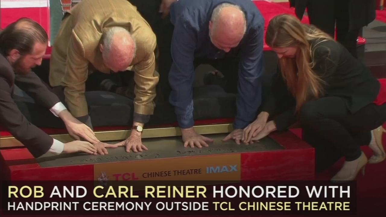 Carl and Rob Reiner dip their hands into cement during their hand and footprint ceremony at the TCL Chinese Theatre on Friday, April 7, 2017.