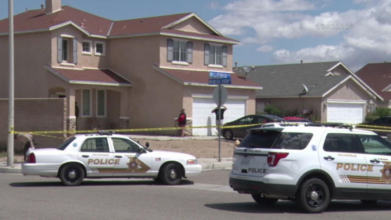 San Bernardino County sheriffs deputies surrounded a home in Victorville after a person was found dead inside on Saturday, April 8, 2017.