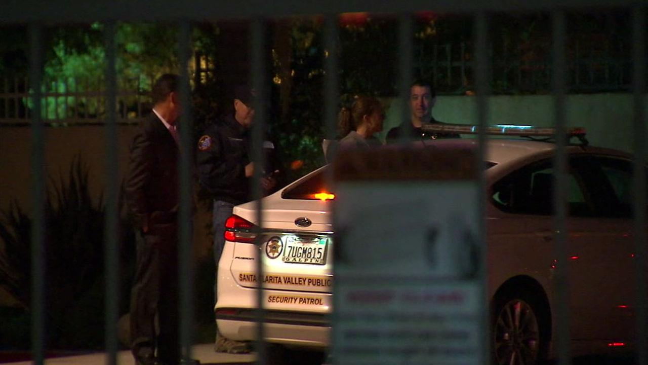 Authorities surrounded a complex after a woman is suspected of stabbing her girlfriend to death during an argument in Santa Clarita on Saturday, April 8, 2017.