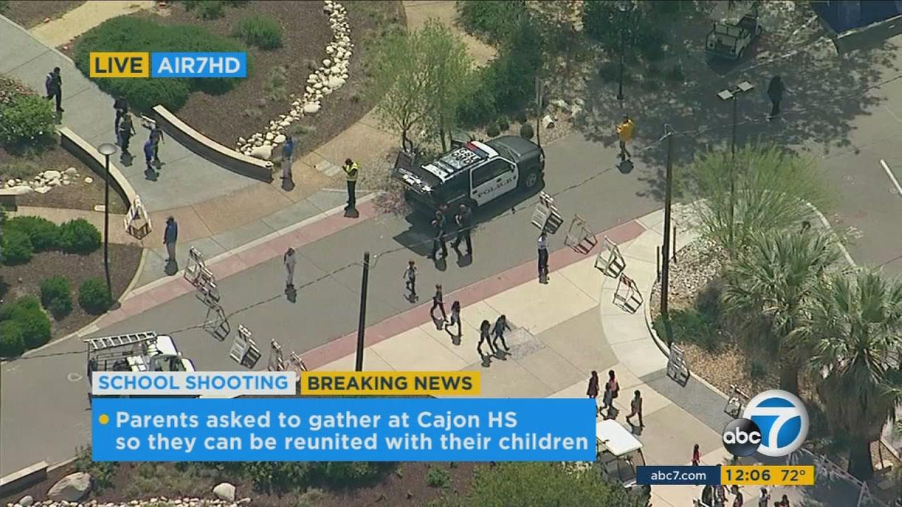 Elementary students transported to a nearby high school after a school shooting in San Bernardino on Monday, April 10, 2017.
