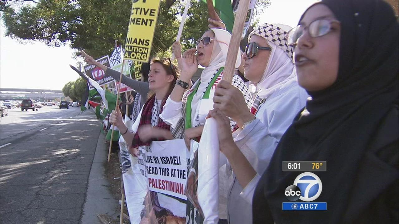 Pro-Palestinian protesters demonstrate outside a federal building in Westwood on Sunday, July 13, 2014.