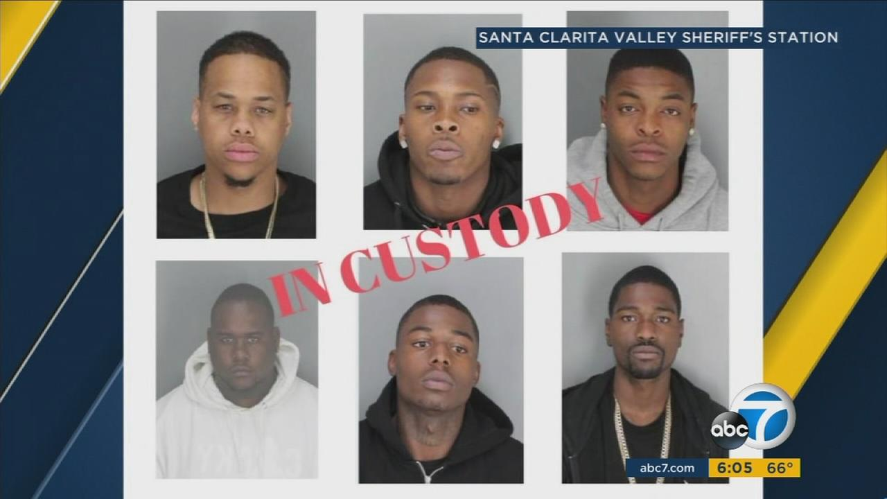 Seven suspects police believe are connected to a much larger burglary ring are shown in mugshots.