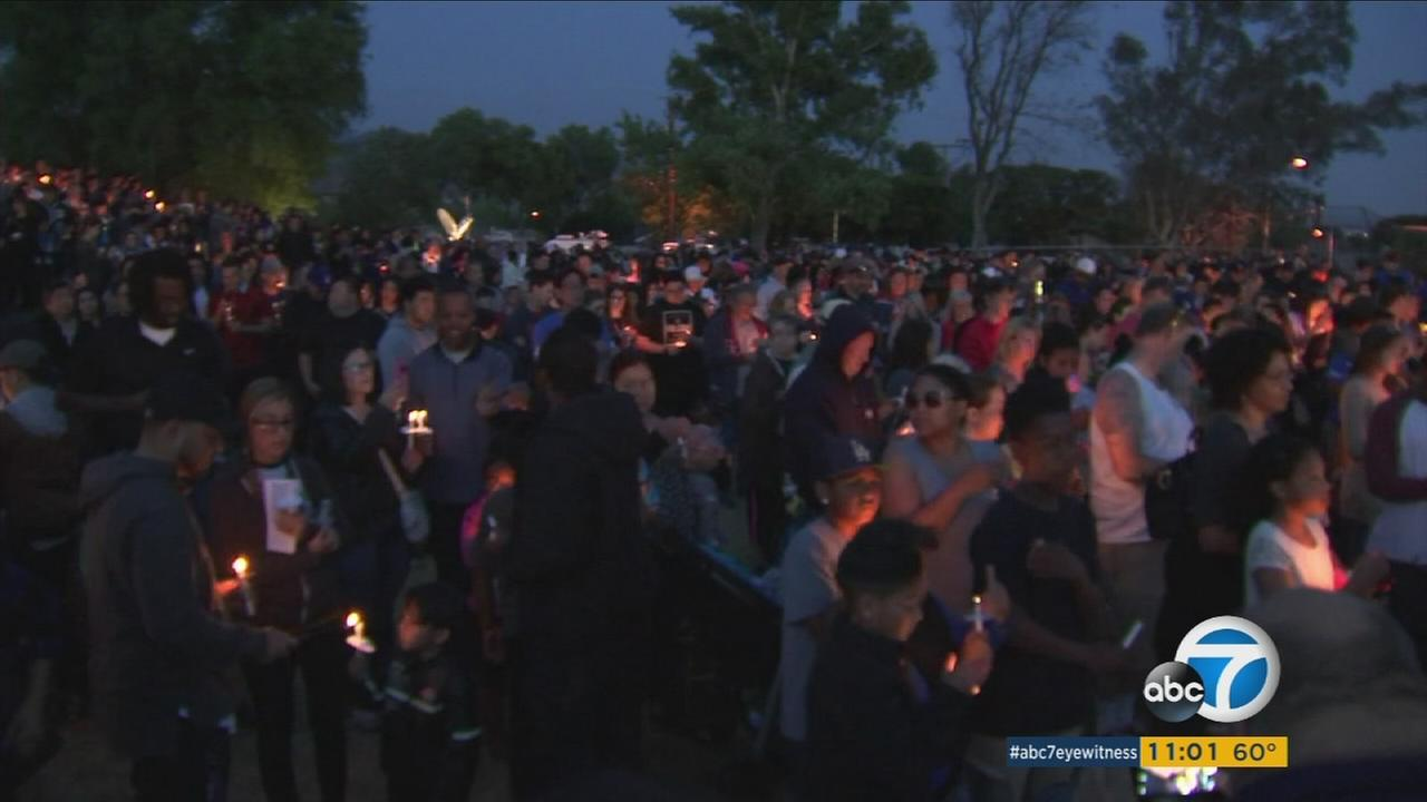 The San Bernardino community gathered Tuesday night for an emotional vigil to remember an 8-year-old boy and a teacher killed by a gunman at an elementary school.
