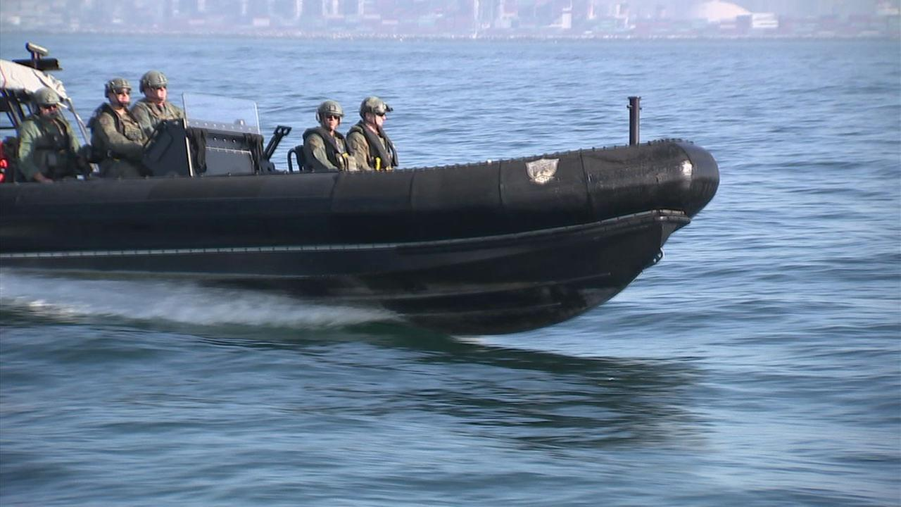 Members of the Maritime Cadre ride the Raptor, a speed boat used as part of the protection of the ports of Los Angeles and Long Beach.