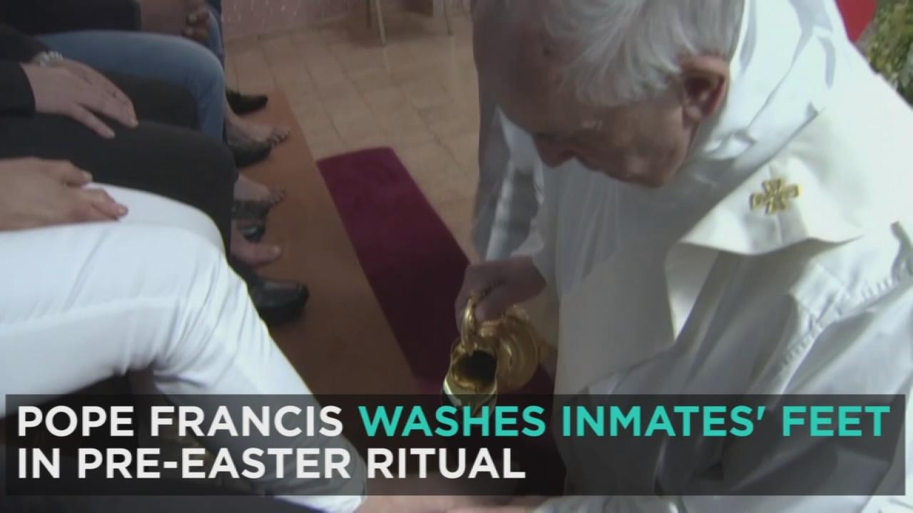 Pope Francis is shown washing an inmates foot in a photo during a Holy Thursday ritual.