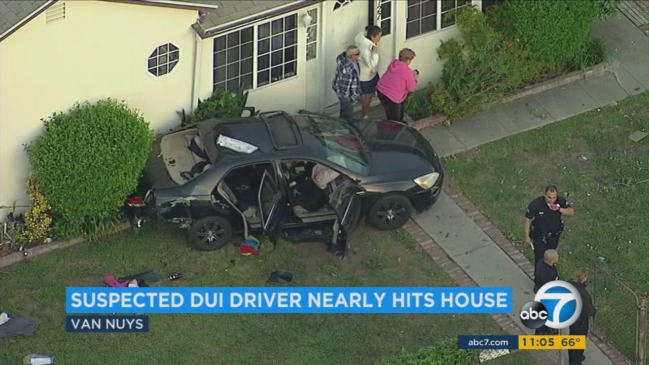 A sedan mangled and wedged up against a home in Van Nuys after an alleged DUI driver crashed with another vehicle on Friday, April 14, 2017.