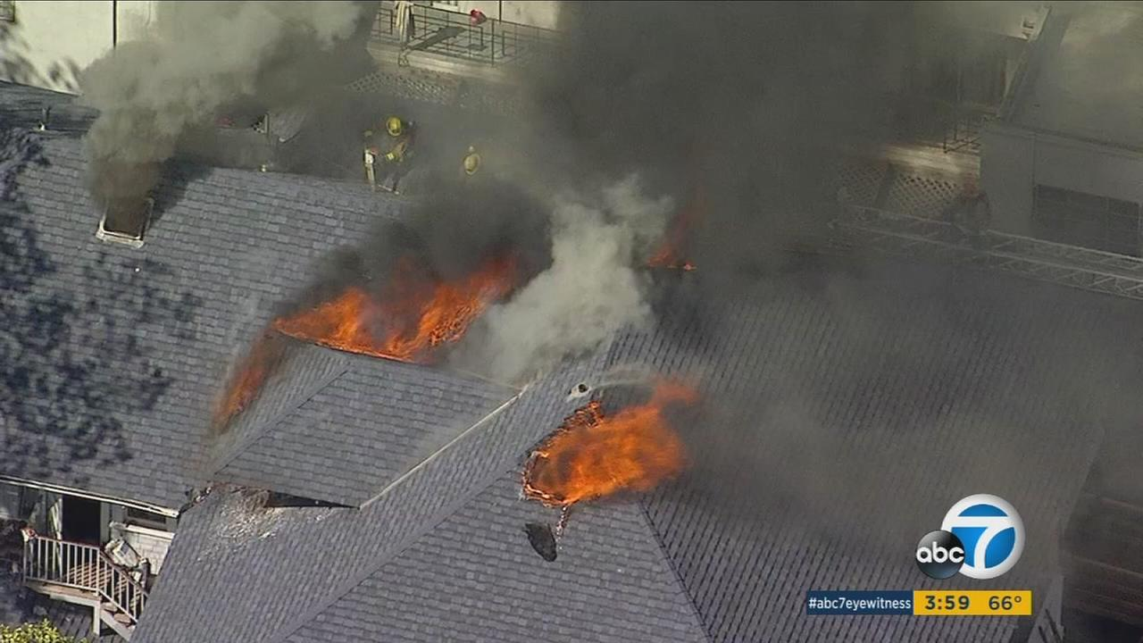 Firefighters knocked down a fire in the attic of a large vacant home in the 1200 block of South Alvarado Street in the Westlake district.
