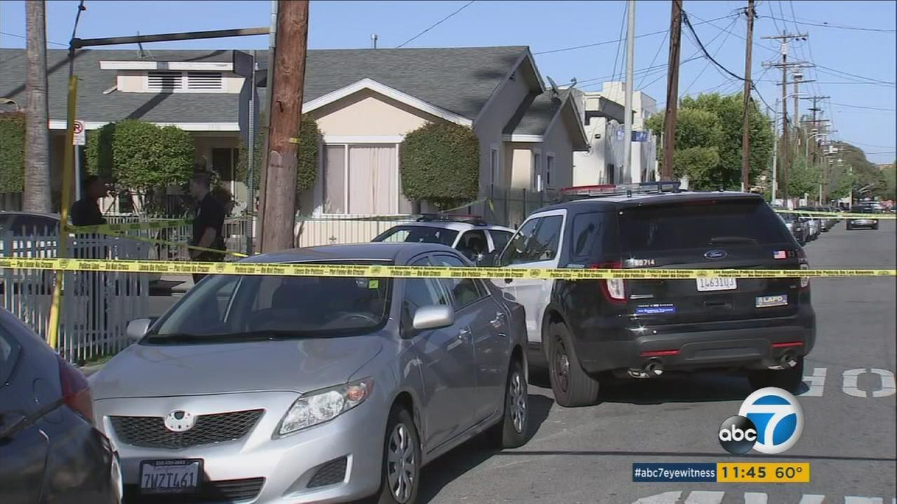 Authorities blocked off an area in Exposition Park after a suspect opened fire on a group in front of a home, shooting a little girl in the face on Saturday, April 15, 2017.