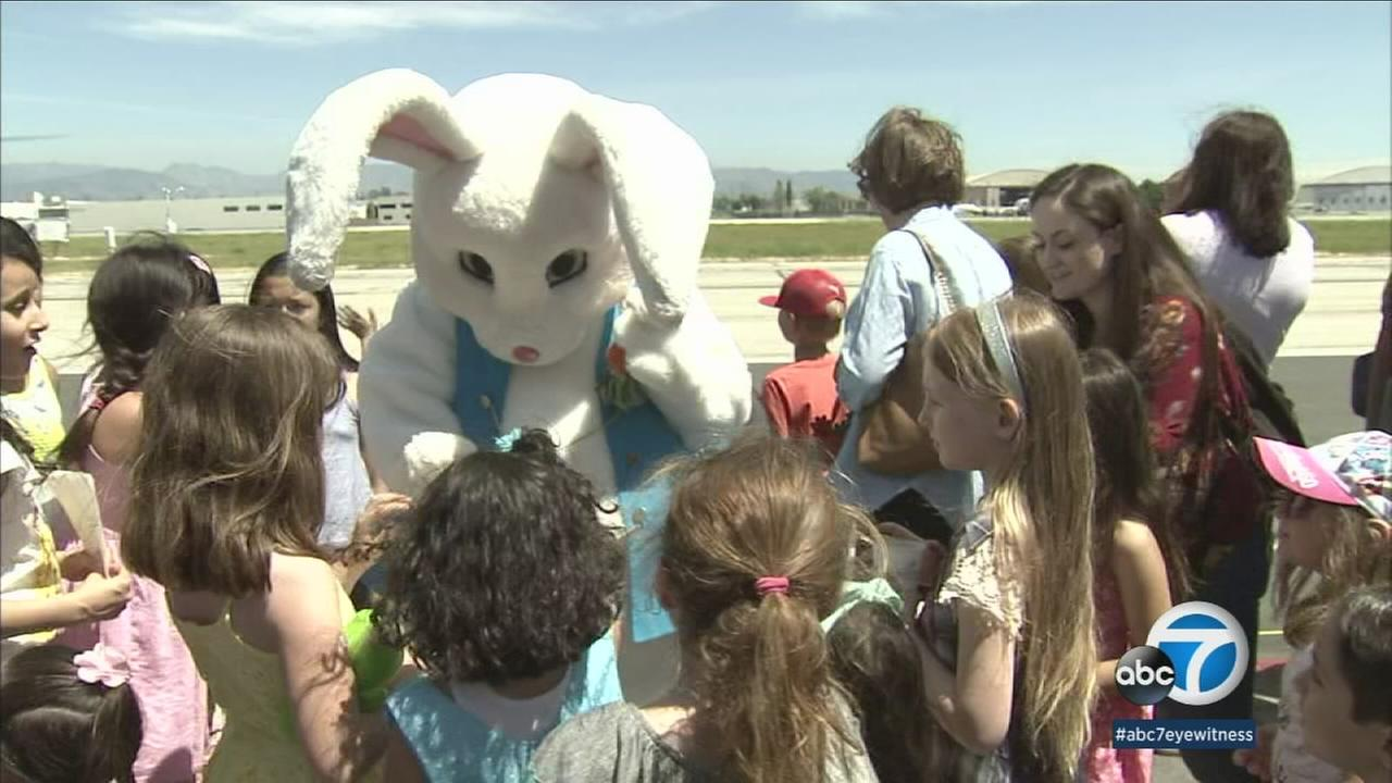 The Easter Bunny arrived in style at Van Nuys Airport on Sunday, hopping out of a helicopter to help hundreds of local families celebrate the holiday.