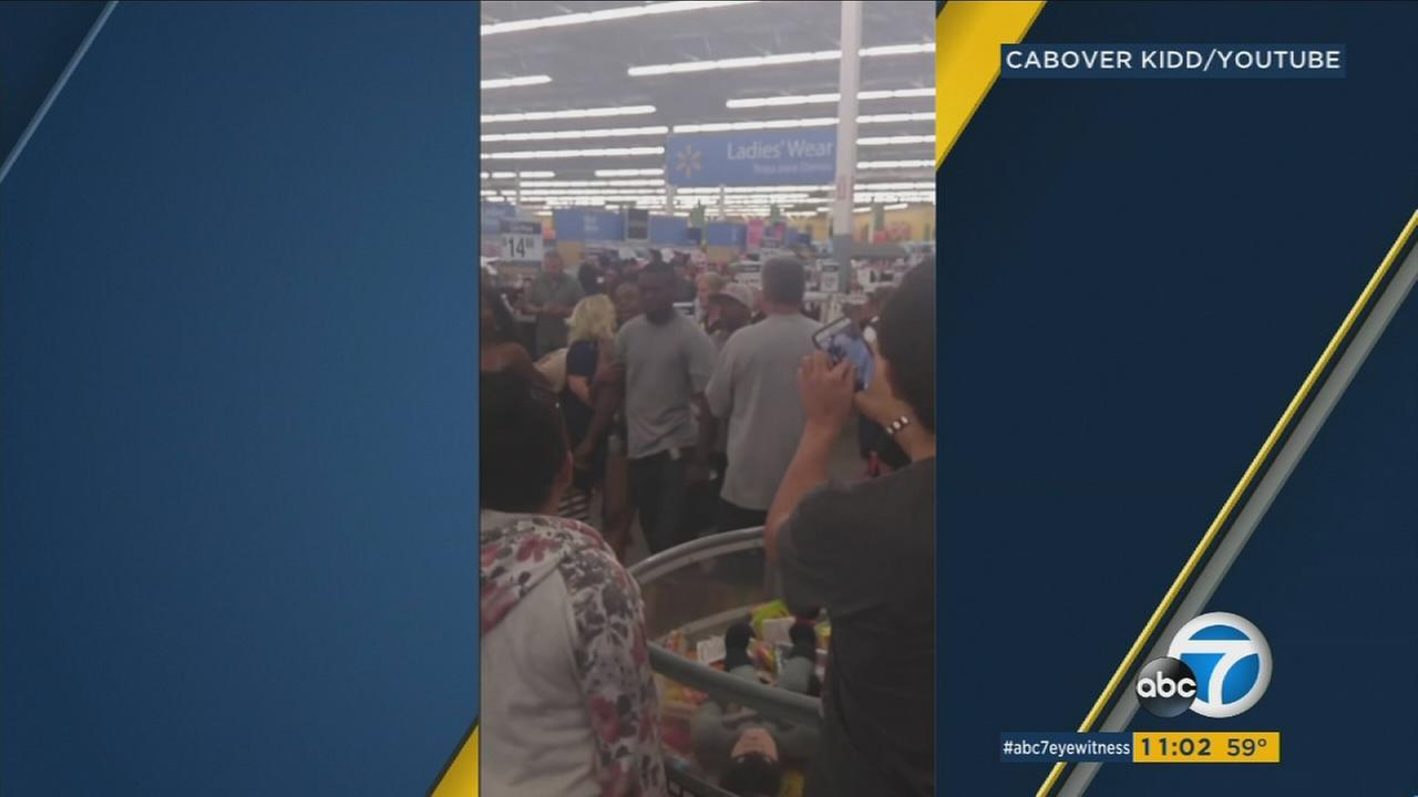 One man was arrested and another is still at-large after an argument among customers at a Hesperia Walmart escalated into a brawl that was caught on video.