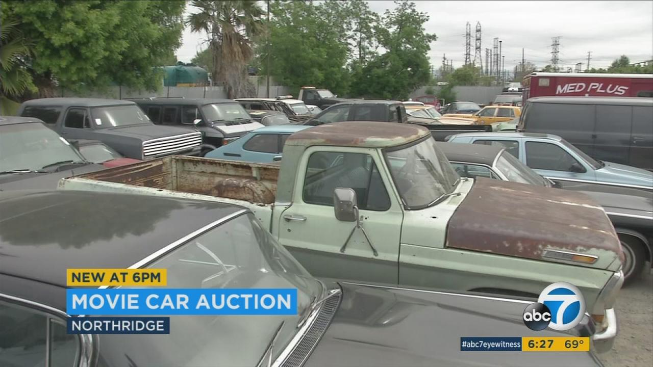 Vehicles that were used in films like Saving Mr. Banks and Argo are being put up for sale in an online auction.