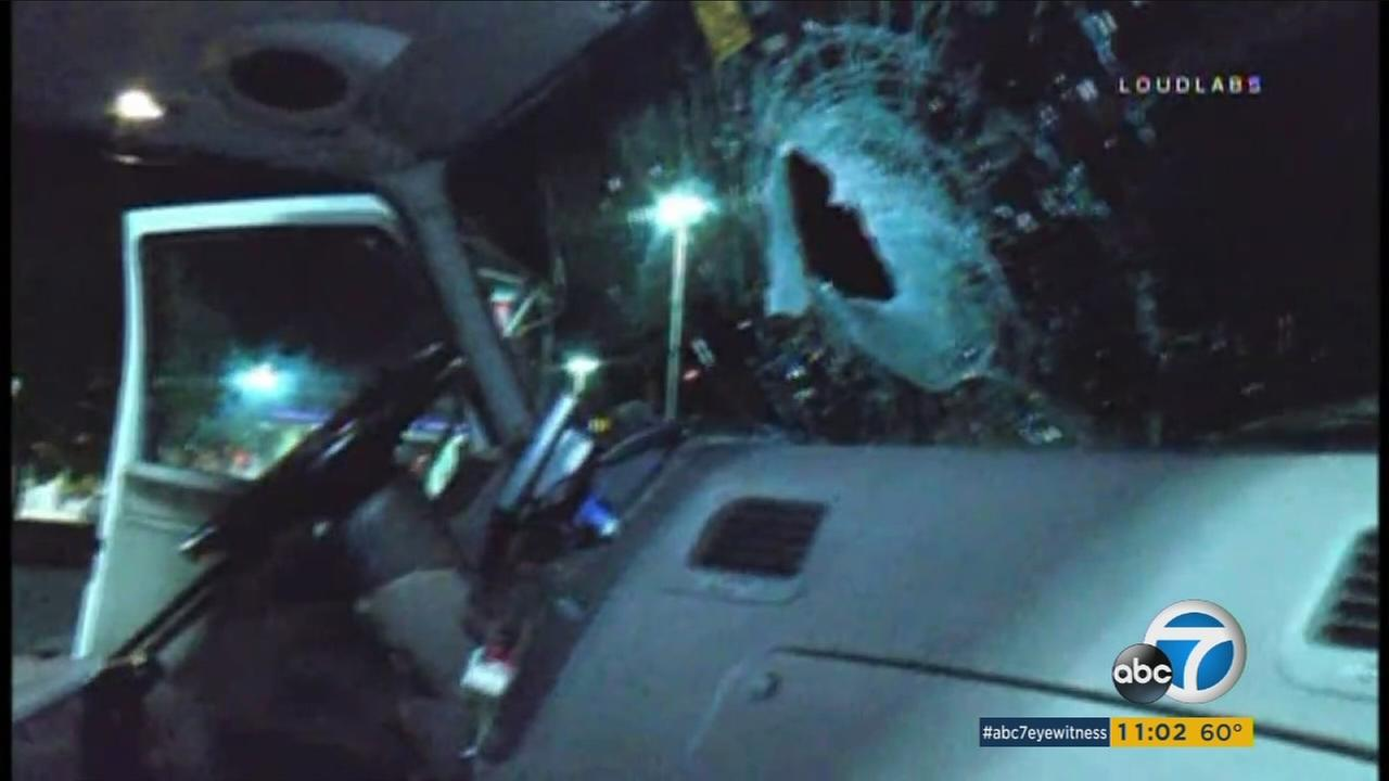 Windshields were smashed and at least one driver suffered a head injury when two men threw bricks at multiple vehicles traveling at high speeds on the 215 Freeway in Perris, witnesses and officials said.