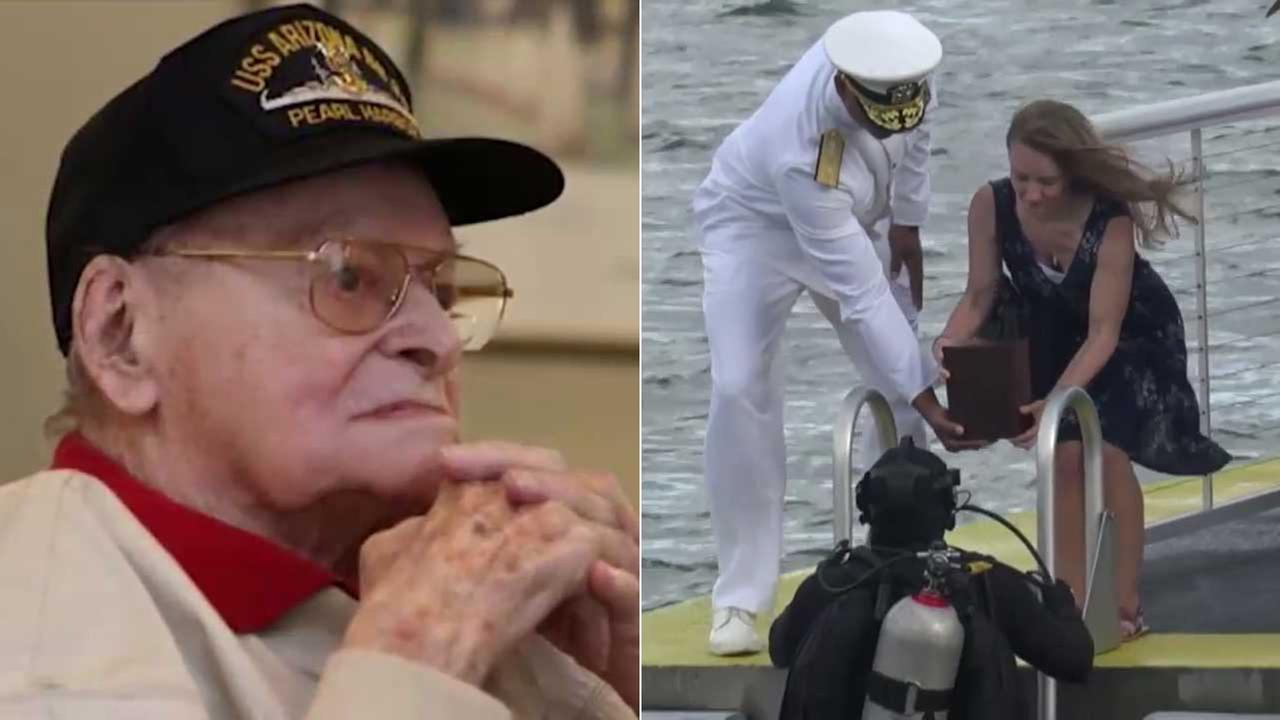 Veteran Raymond Haerry (left) - who survived Pearl Harbor and died last year at age 94 - was reunited with his fallen shipmates aboard the sunken USS Arizona in a solemn ceremony.
