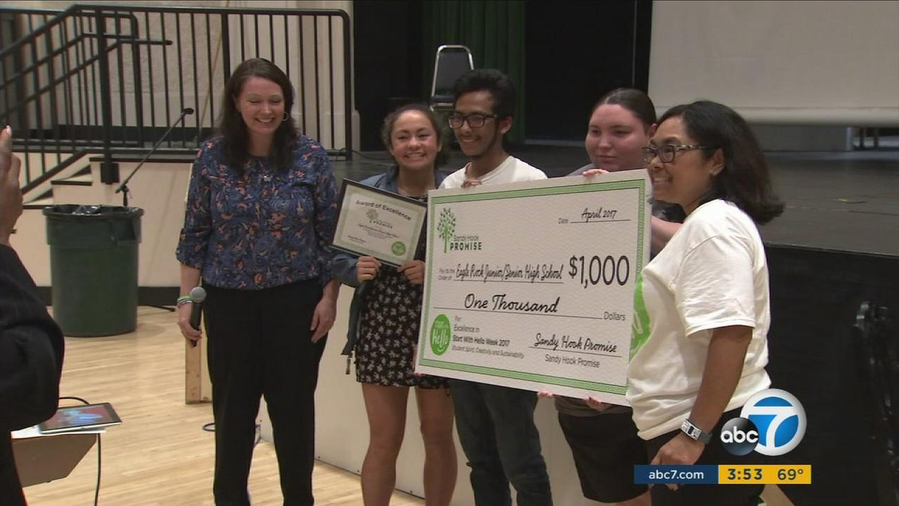 Students at Eagle Rock Junior and Senior High School hold up a $1,000 check given to them by the Sandy Hook Promise organization.