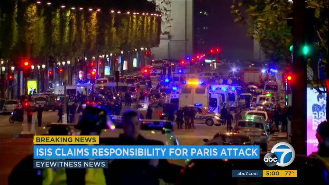 The attacker opened fire on police in Paris iconic Champs-Elysees shopping district Thursday night, killing one officer and wounding another before police shot and killed him.