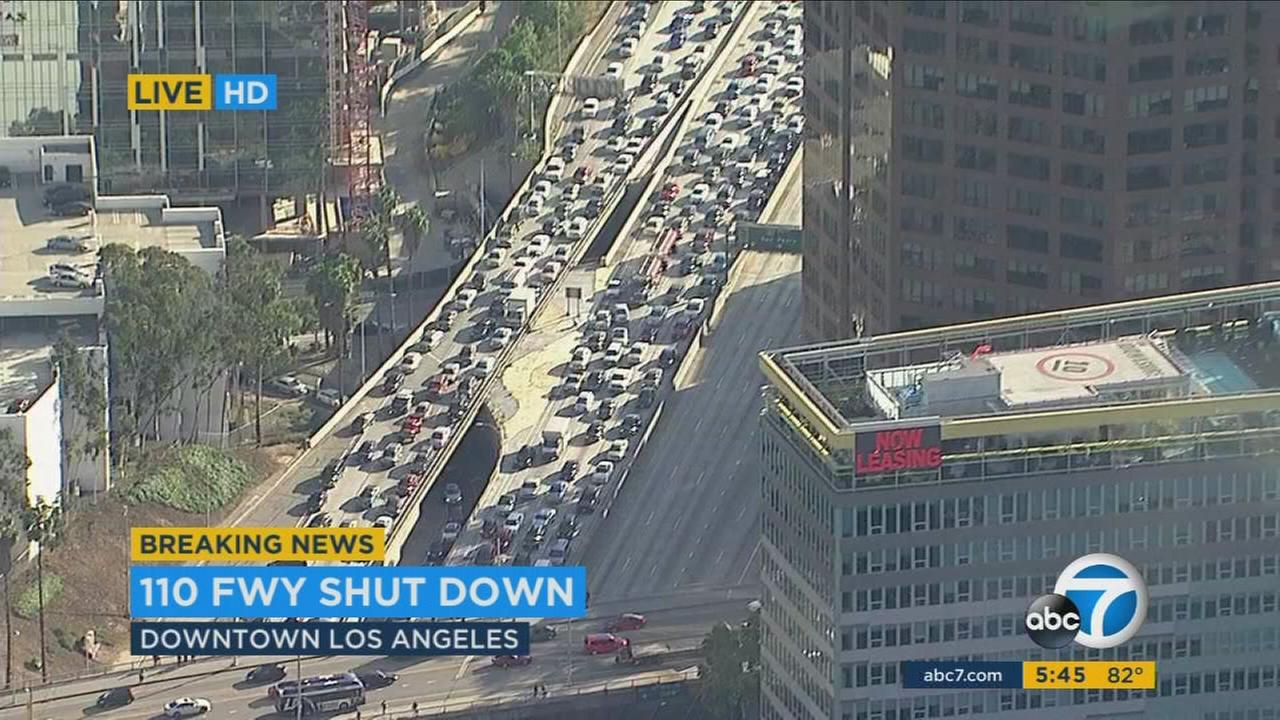 Both directions of the 110 Freeway in downtown Los Angeles were shut down during rush-hour traffic on Friday due to a person threatening to jump off an overpass.