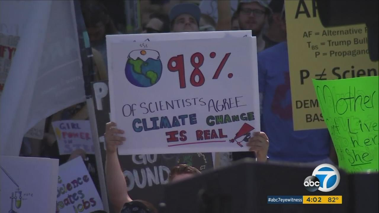 A demonstrator held up a sign in the March for Science in downtown Los Angeles on Saturday, April 22, 2017.