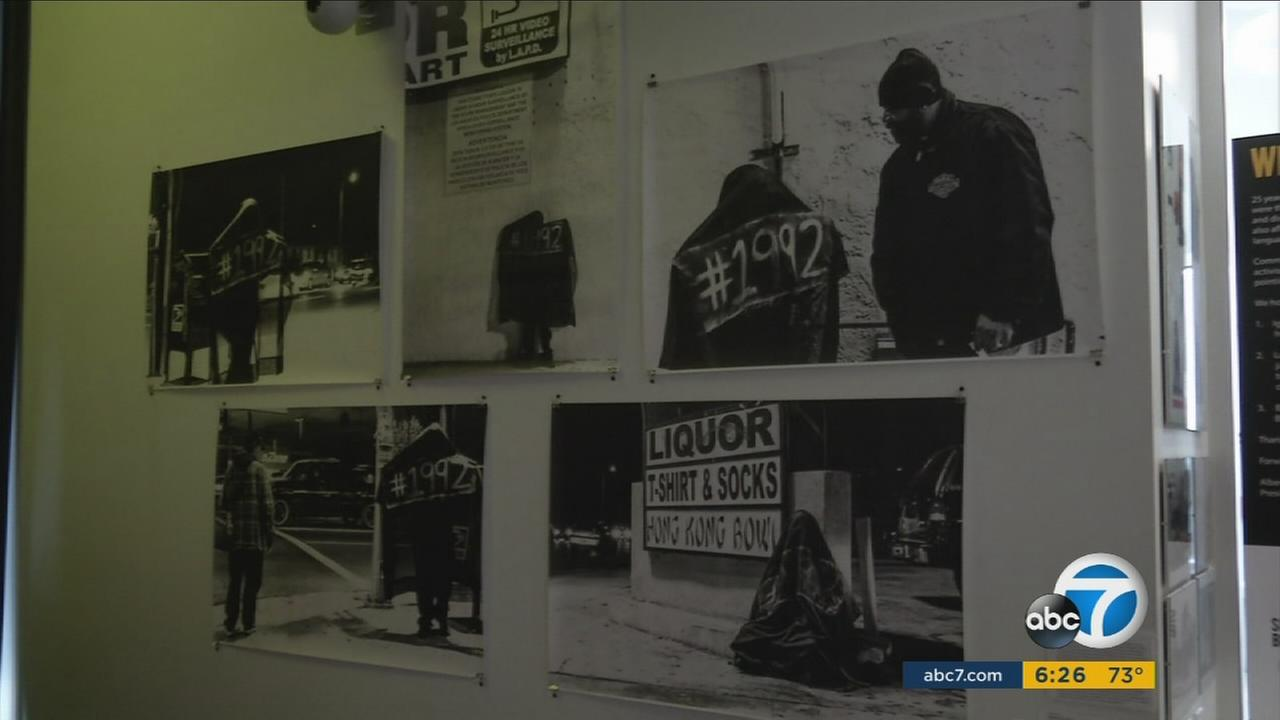 Photos taken during the 1992 Los Angeles riots are shown as part of the Re-Imagine Justice exhibit at the Community Coalition in South L.A.