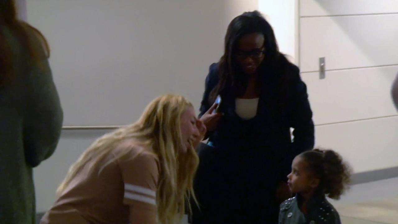 Kayla Greenwood (left) greets Jasmine Johnson and her 3-year-old daughter.