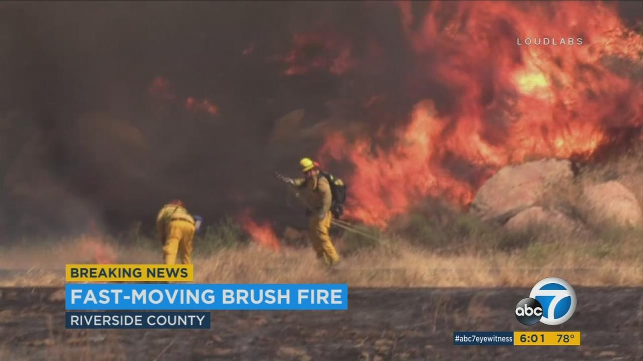 Fanned by strong winds, multiple brush fires are burning Sunday in parts of Riverside and San Bernardino counties.