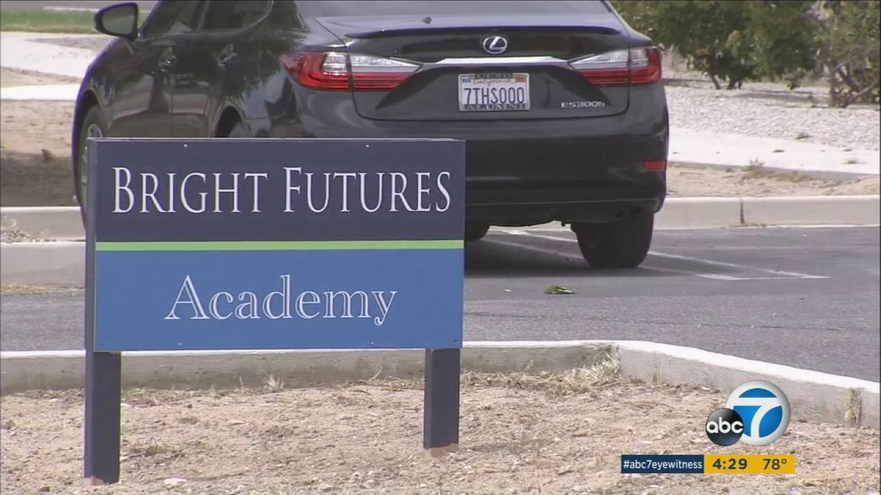A sign for Bright Futures Academy in Apple Valley is shown.