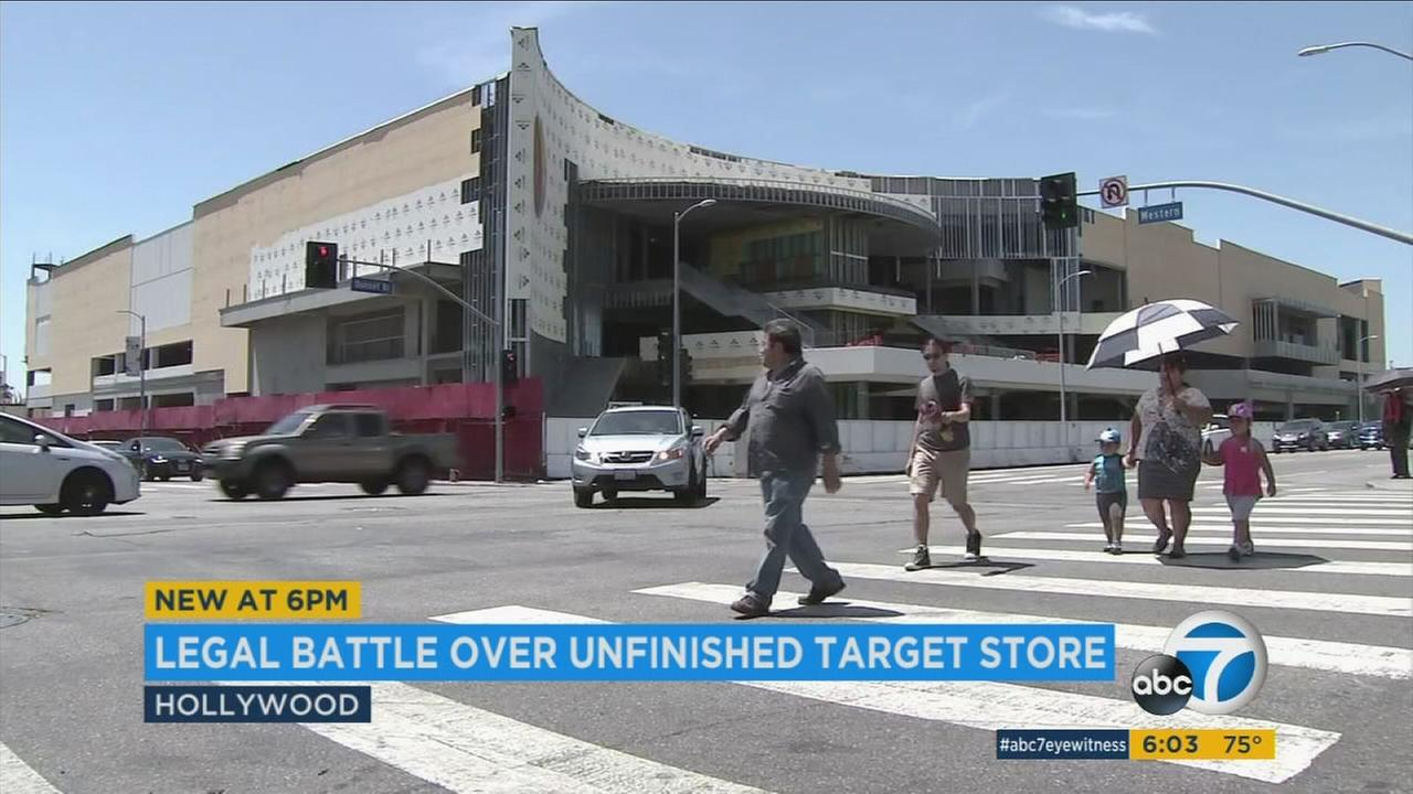 People walk across a large, unfinished Target store in Hollywood in an undated photo.