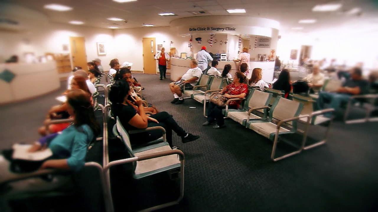 An undated photo of patients sitting in the waiting room of a medical facility.
