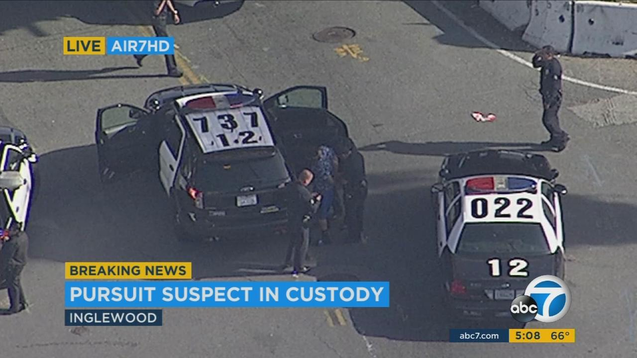 A man was arrested Monday after physically assaulting a television news reporter and leading police on a chase through South Los Angeles that ended in Inglewood.