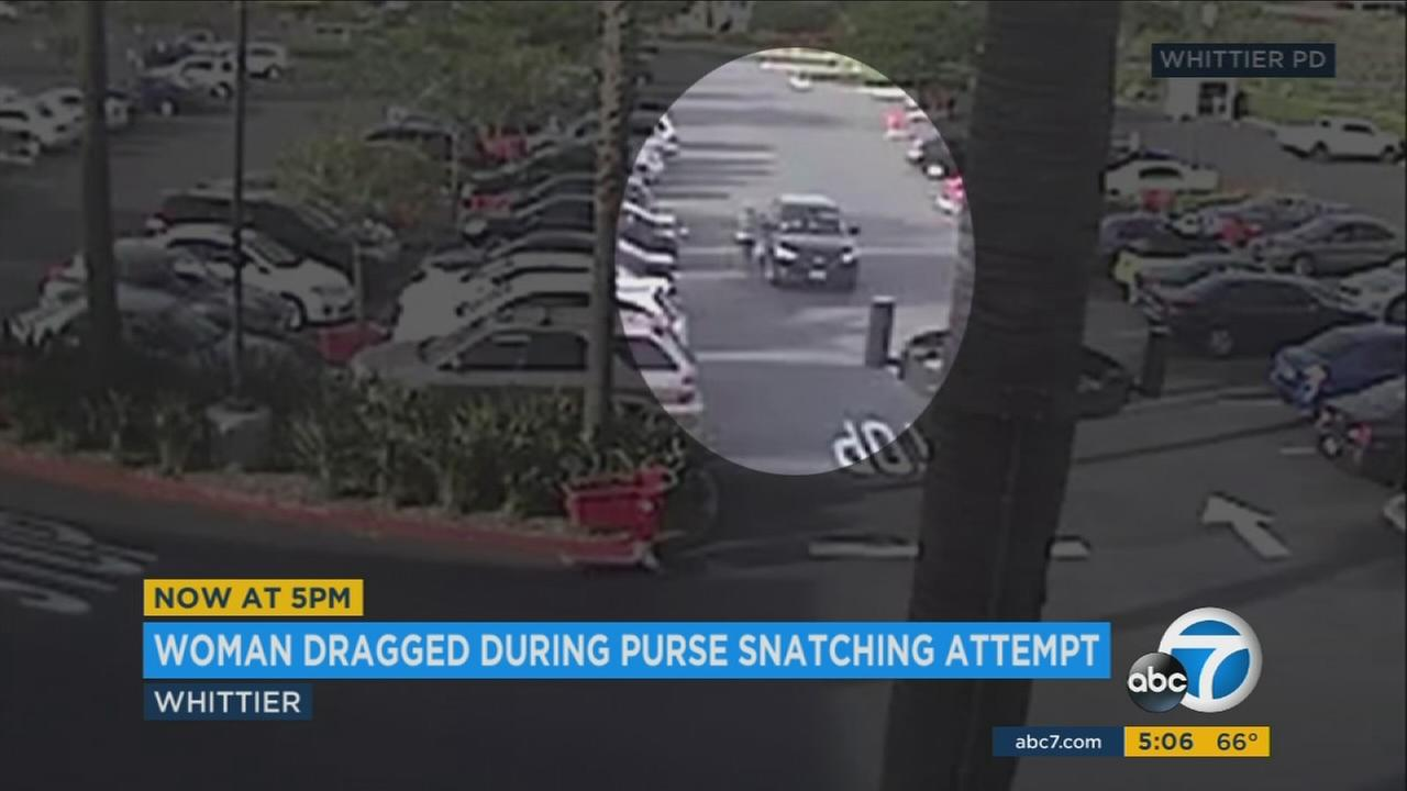 Surveillance video shows a car dragging a woman in a parking lot in Whittier.