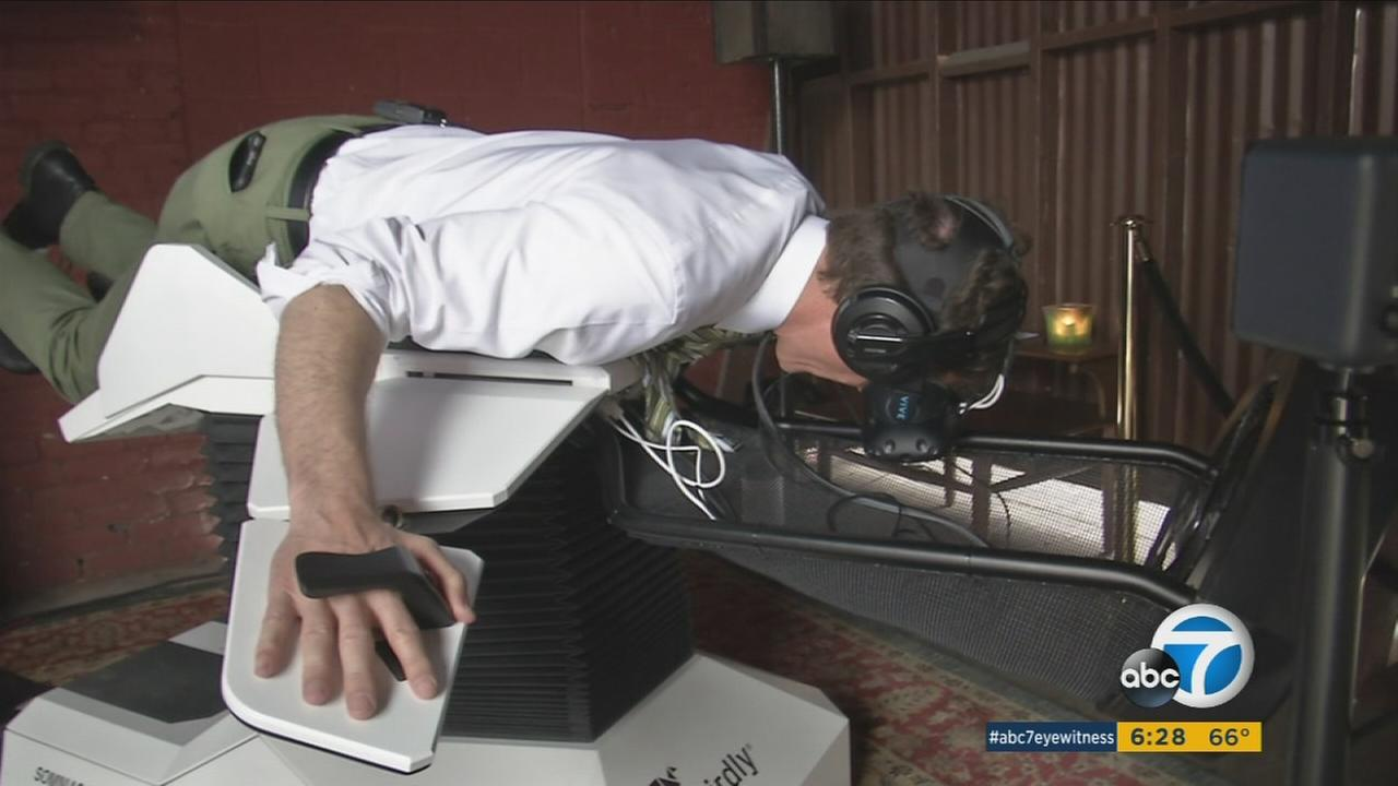 ABC7 reporter Rob Hayes is shown trying out the Birdly virtual reality device during a trial run in downtown Los Angeles.