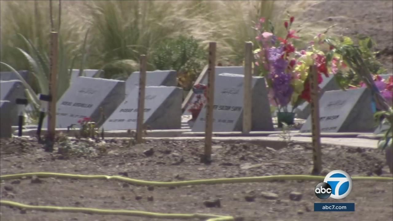 Plots in a Corona cemetery are shown.