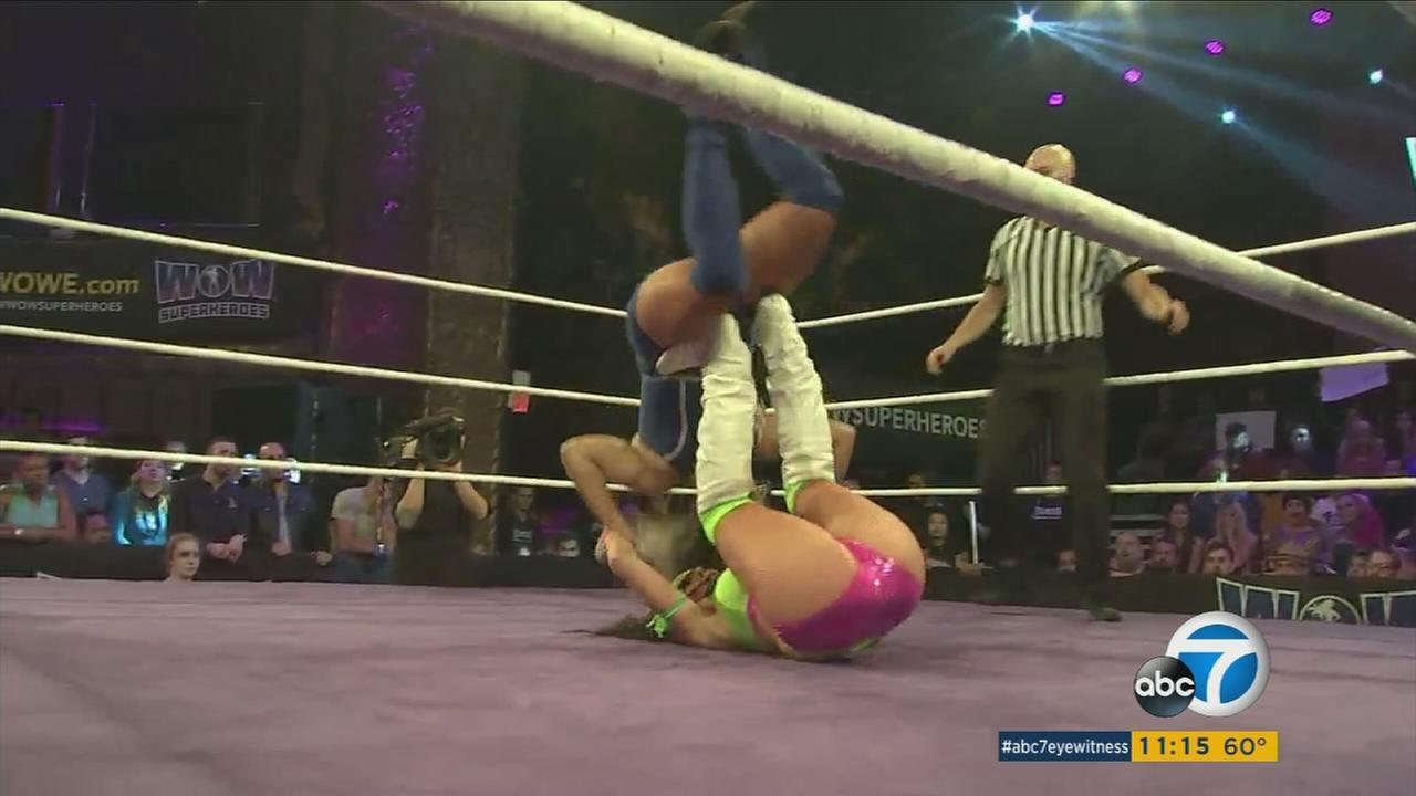 Two women wrestle in an entertainment promotion held by Jeanie Buss and David McLane.