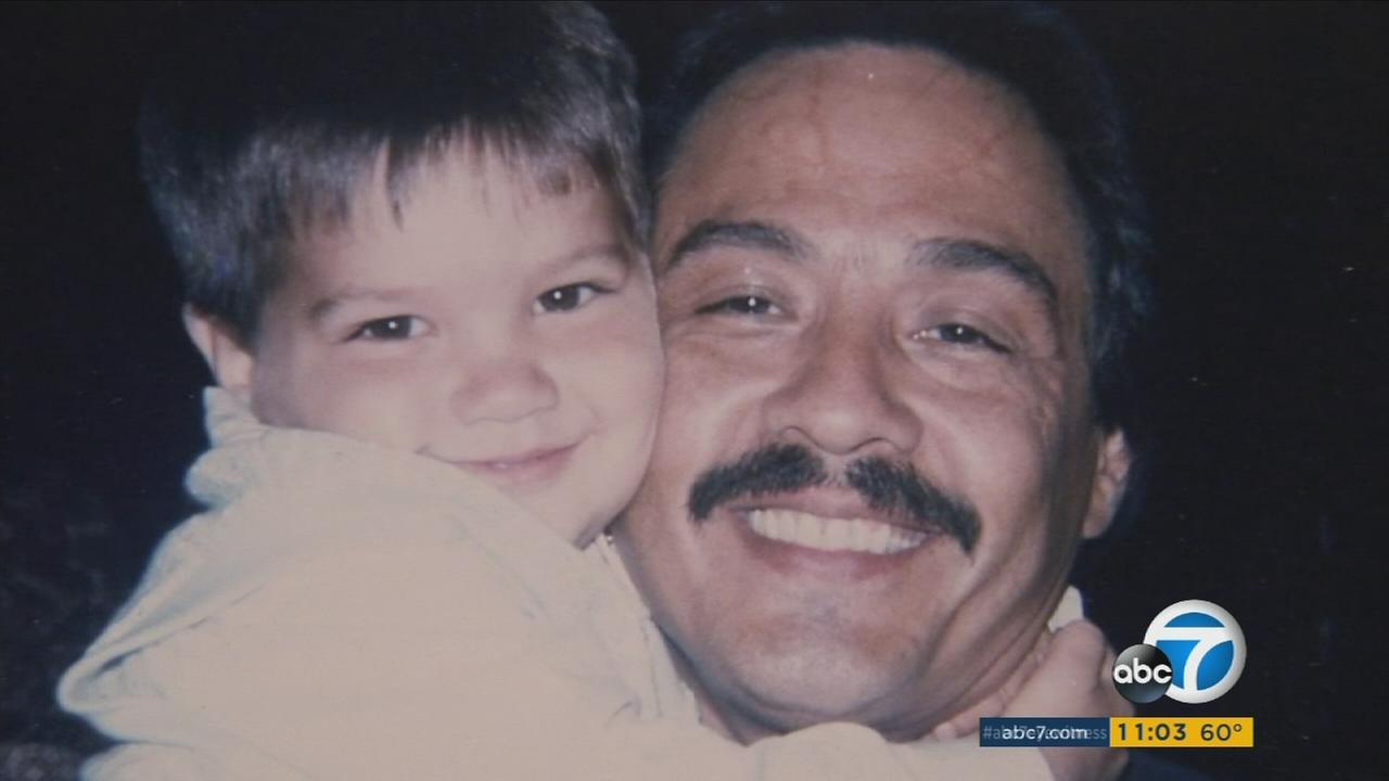 George Aguilar, 46, is shown with his son in an undated photo.