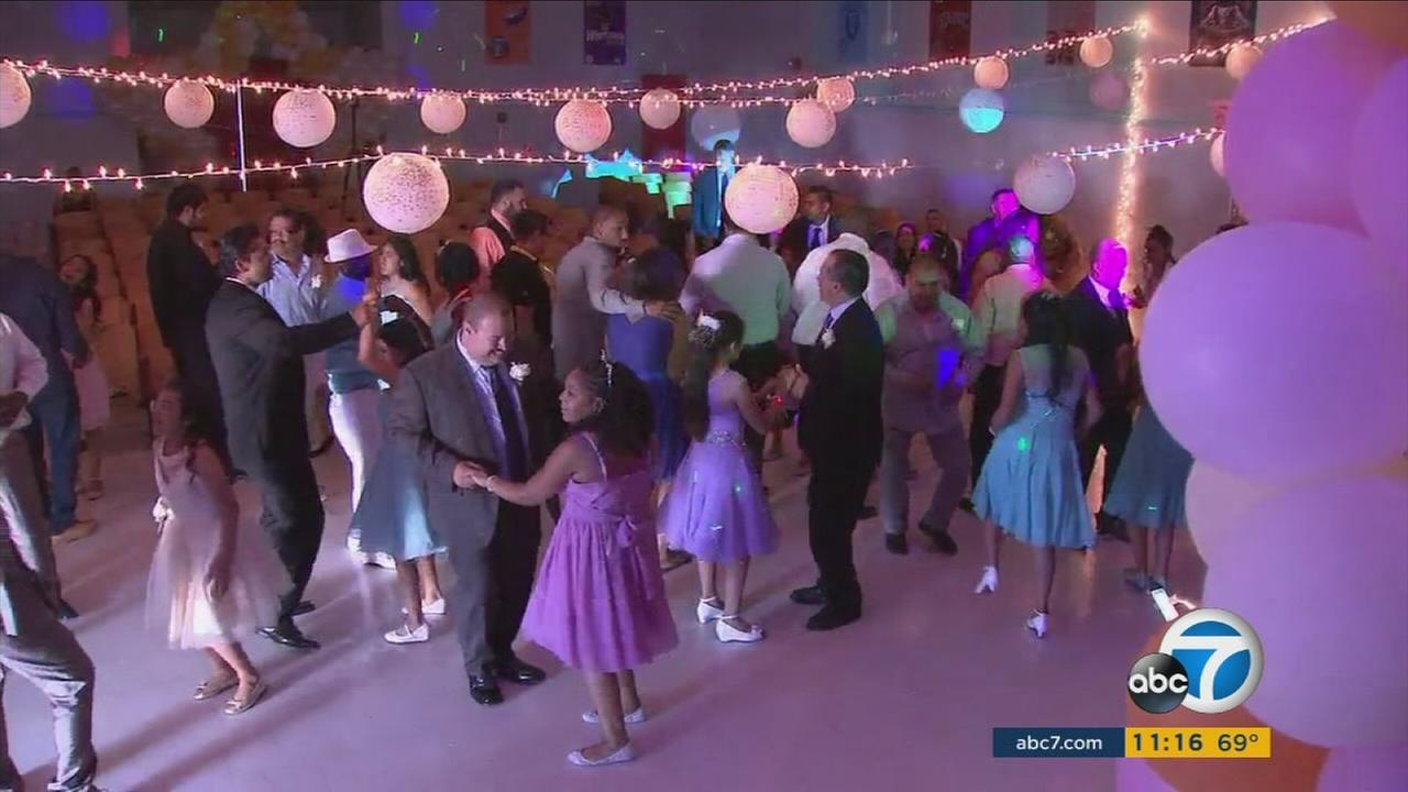 Fathers and daughters dance at a Compton Elementary School dance.