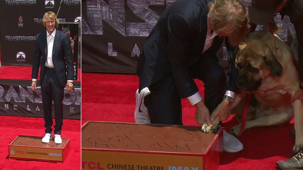 Michael Bay and his dog Rebel are shown during the hand and footprints ceremony at the TCL Chinese Theatre on Tuesday, May 23, 2017.