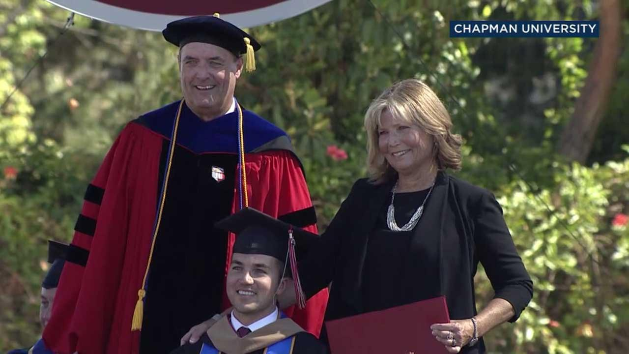 Judy OConnor and her son Marty pose for a photo during commencement at Chapman University in Orange, Calif. on Saturday, May 20, 2017.