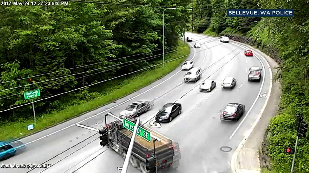 Traffic camera footage shows a dump truck slamming into a car in Bellevue, Washington.