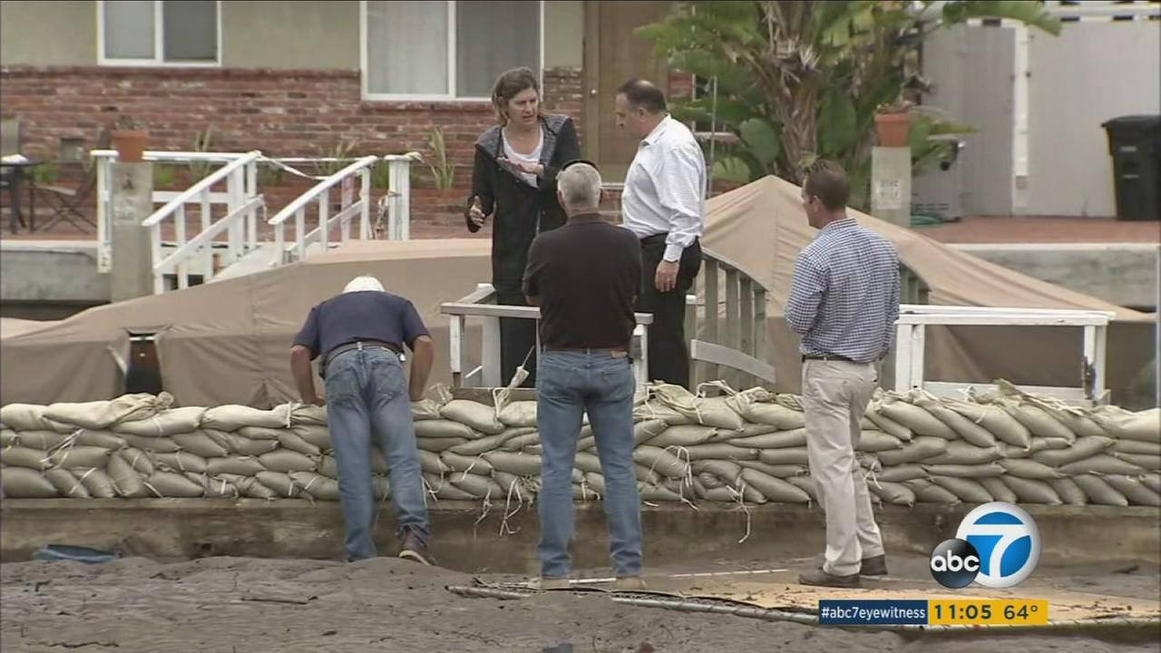 Crews rush to prevent more flooding in Newport Beach