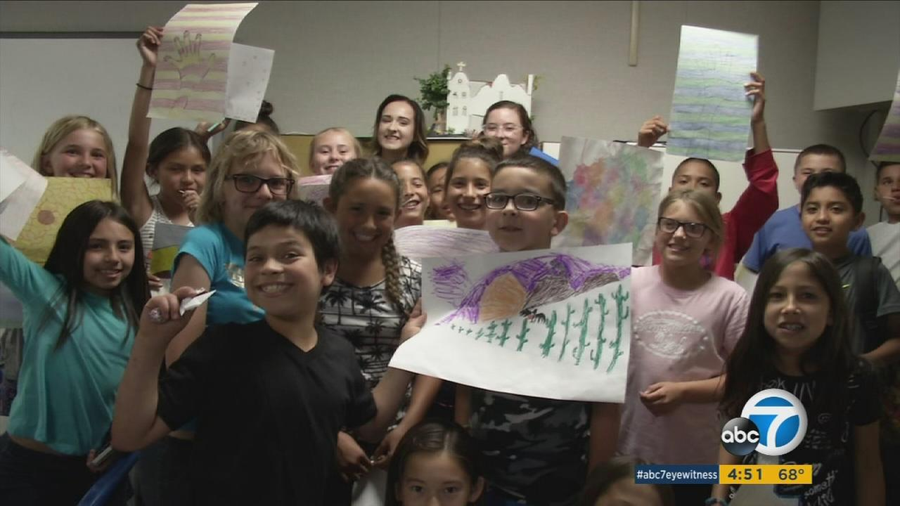 Emma Thompson and Marin Trunkey are shown with their art students at Highlands Elementary School.