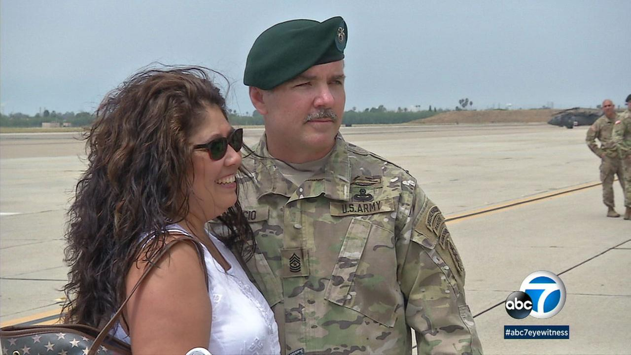 Sergeant Major Hank Eylicio and his wife Lena as they reunite at the Los Alamitos base in Orange County.