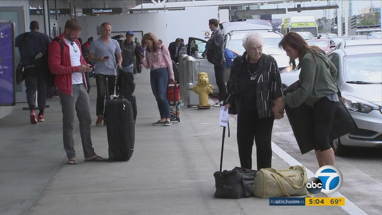 Travelers arrive at Los Angeles International Airport to brave the heavy crowds during the Memorial Day weekend.