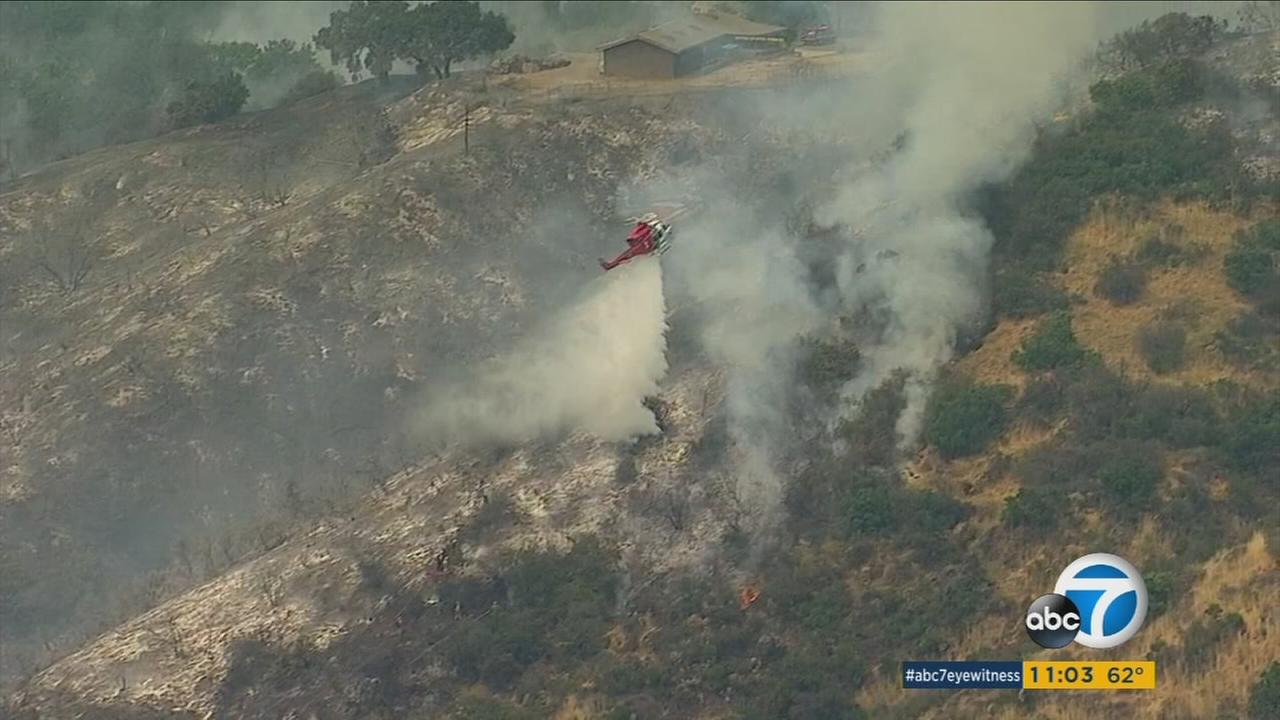More than 150 firefighters were battling a brush fire that had burned 55 acres above Brentwood.