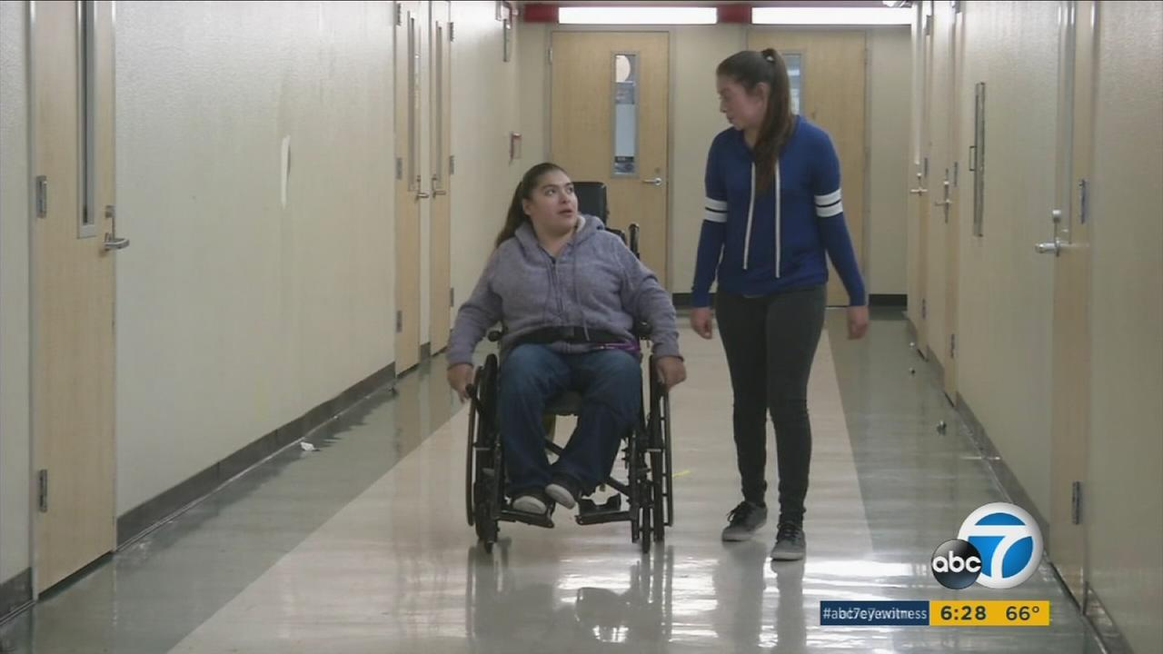 Elizabeth and Lizbeth Gomez are shown travel through the halls of their high school.