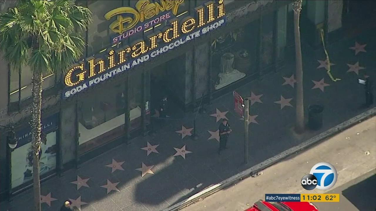 A pit bull was shot by an off-duty Los Angeles police officer inside the Ghirardelli Ice Cream and Chocolate Shop in Hollywood.