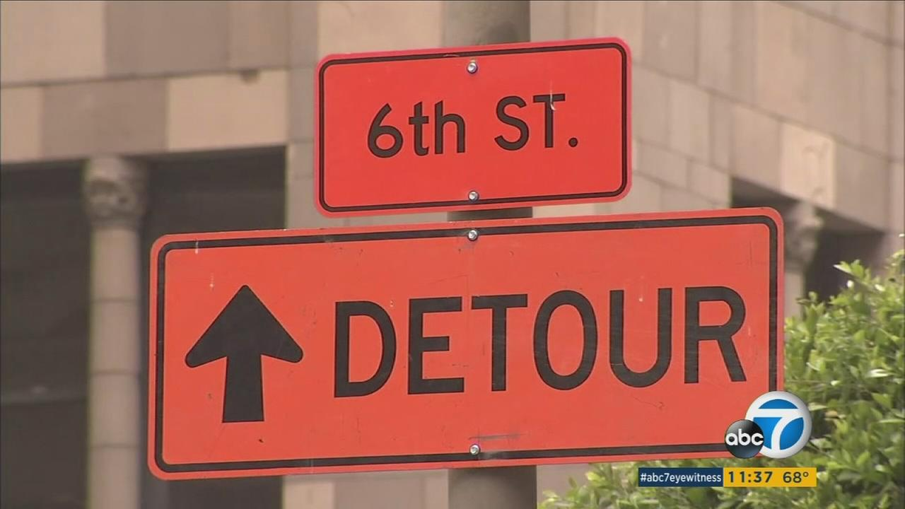 A sign points indicates a detour route during the monthslong closure of 6th Street in downtown Los Angeles.