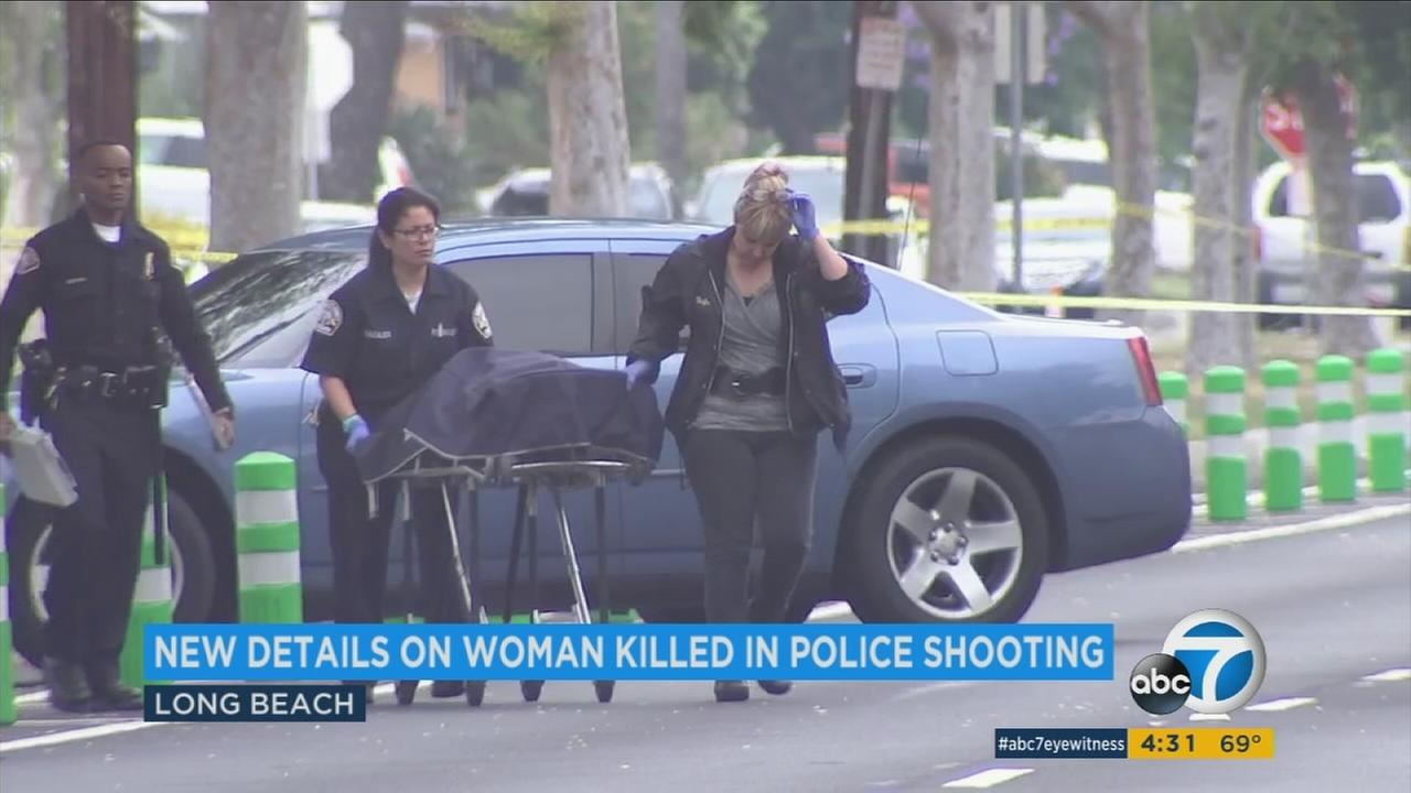 A womans body is wheeled out of a crime scene after she was killed in an officer-involved shooting in Long Beach on Thursday, May 8, 2017.