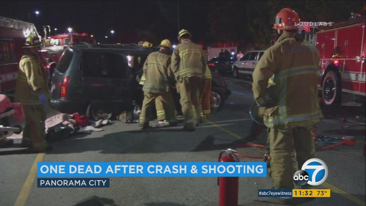 Firefighters rescue four people from a van that crashed after a possible car-to-car shooting in Panorama City on Friday, June 9, 2017.